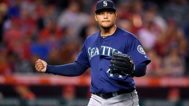 Seattle Mariners starting pitcher Taijuan Walker claps after finishing the fifth inning of a baseball game against the Los Angeles Angels, Tuesday, Sept. 13, 2016, in Anaheim, Calif.