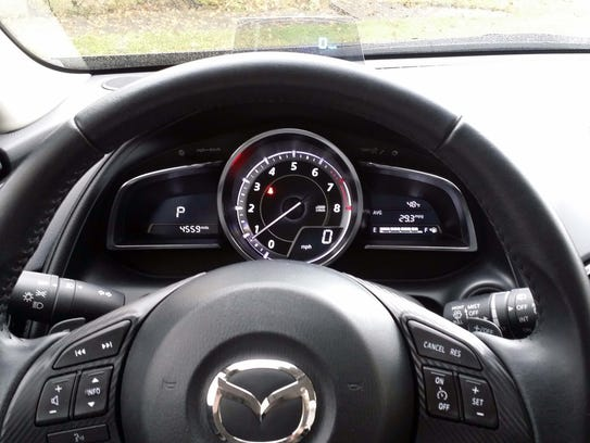 The dominating tachometer renders the speedometer a