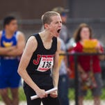 Lafayette Jeff's Daniel Feltis, 135, receives the baton from teammate Shane Shipley during the 3,200 relay at the 2014 sectional.