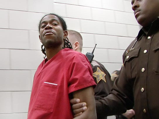 Ronald Davis, 30, is escorted to court on Jan. 23,