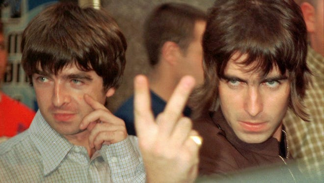 Liam and Noel Gallagher of the band Oasis arrive at Radio City Music Hall in New York, September 4, for the 1996 MTV Video Music Awards. Oasis performed at the awards ceremony.