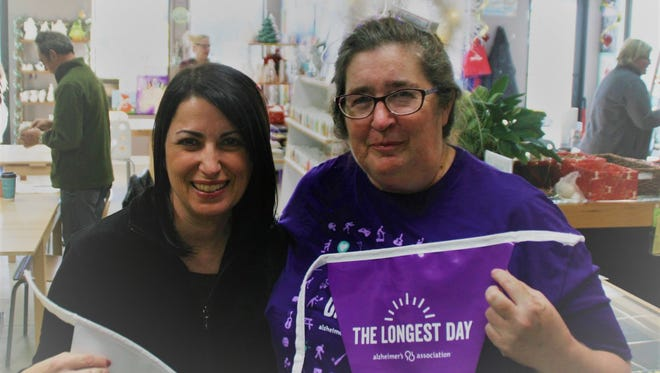 Jennifer Siesel, left, and Susan Scherer promote the Alzheimer's Association's The Longest Day at the Three Legged Wildebeest Art Studio in Port St. Lucie.