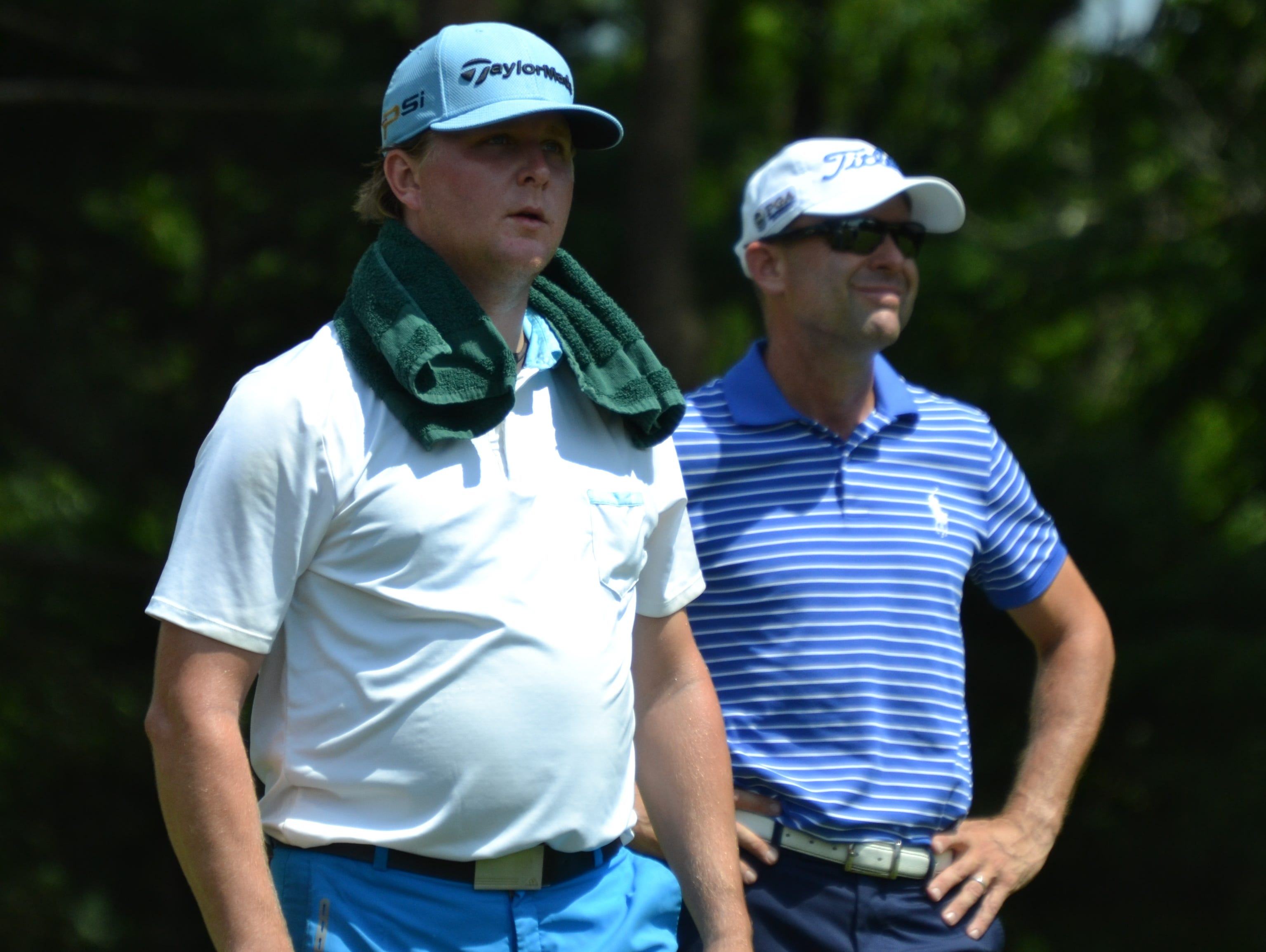 Peter Ballo (left) and Rob Labritz watch the other member of there group, Dennis Hillman tee off during the final round of the Westchester Open Wednesday at GlenArbor Golf Club.