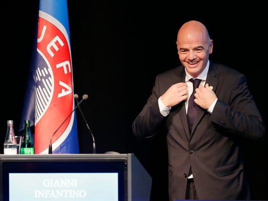 Presidential candidate Gianni Infantino enters the stage for a speech during the UEFA meeting in Zurich, Switzerland, Thursday, Feb. 25, 2016. The Sepp Blatter era at FIFA is set to finally end Friday, Feb. 26, 2016 when soccer's scandal-scarred world body picks a new president after nine months of crisis. (AP Photo/Michael Probst)