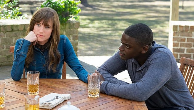 """Daniel Kaluuya, right, spends a strange weekend in the country with his girlfriend, Allison Williams, in """"Get Out."""""""