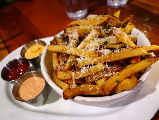 Downtown devil fries with pequin chile, parsley and