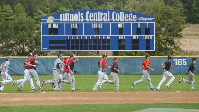 Players warm up before tryouts for the Central Illinois Outlaws, a club baseball organization in the Peoria area that altered its schedule to accommodate the extended high school season.