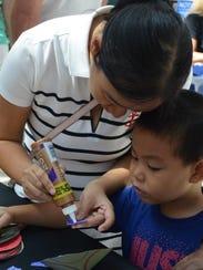 "Children work on crafts to celebrate ""Marinelife Day"