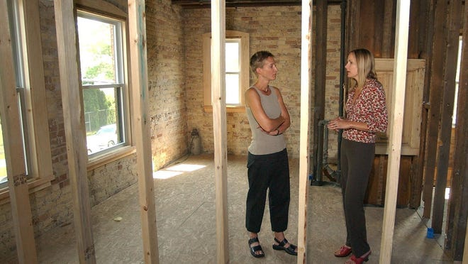 Terri Strodthoff, director of the Alma Center, a domestic violence service for men, and Debbie Ramirez, coordinator for Alma Center, check on a building they were renovating for the service in 2004.