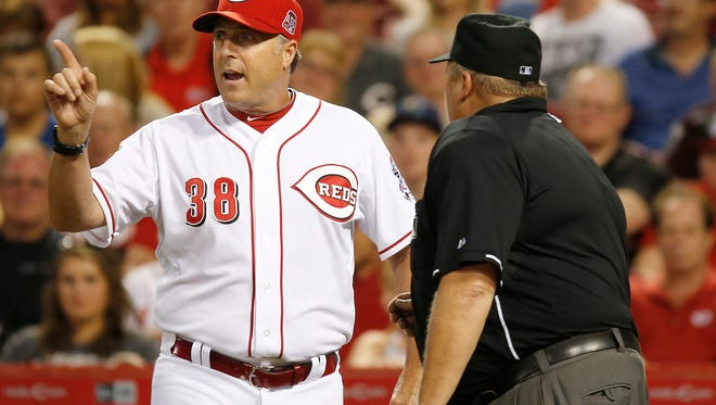 Cincinnati Reds manager Bryan Price (38), left, argues with umpire Fieldin Culbreth (25) after a hit by Chicago Cubs left fielder Chris Coghlan (8) was ruled a home run in the top of the sixth inning.