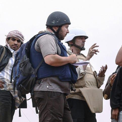 Sotloff, center, talks to Libyan rebels on the Al Dafniya front on June 2, 2011, in Misrata, Libya.  Sotloff was kidnapped in August 2013 near Aleppo, Syria.