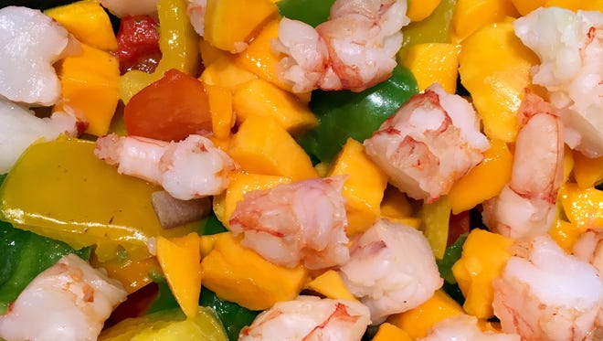 Mango Shrimp Salsa can be served with corn tortilla chips, on crostini or in romaine lettuce cups
