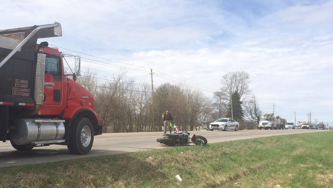 A motorcycle rests on the shoulder of National Road West after it was struck by a dump truck Wednesday.