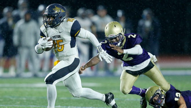 Victor's Joseph Theede gets away from Christian Brothers Academy's DeAndre Dowdell for a touchdown in the fourth quarter of Victor's 42-13 victory at Cicero-North Syracuse on Nov. 19, 2016.