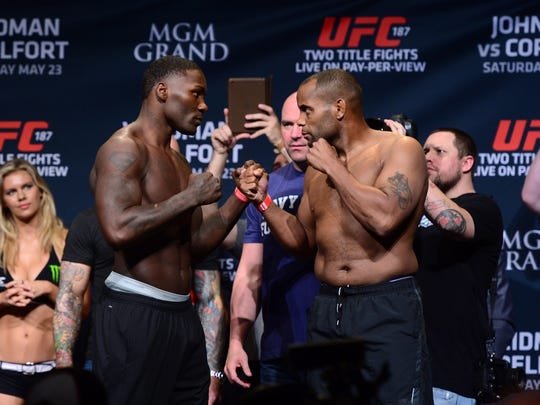 Anthony Johnson (left) and Daniel Cormier face off after weighing in for their 2015 light heavyweight bout at UFC 187.