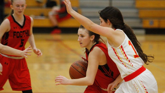 Foothill High's Rikki Sherman dribbles around Chico High's Maddie Meuter during their game Tuesday in Chico.