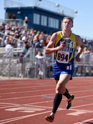 West Central's Derick Peters leads the way in the 3200-meter