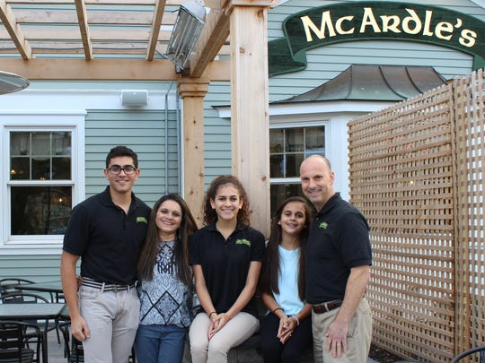 From left: Ryan, Dola, Priya Alyssa and John Albert at their family-owned McArdle's Restaurant.