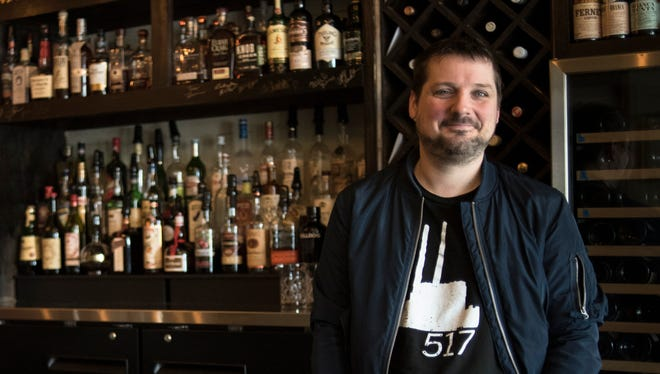Justin King, owner and general manager of Bridge Street Social in downtown DeWitt at the restaurant on March 28, 2018.