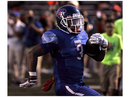 Cooper High School running back Tyrees Whitfield runs