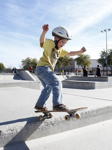 Derik Colwill, 5, of Glendale, skates at the skate park at Rio Vista Community Park in Peoria on January 16, 2016. Peoria is moving forward on plans to open a new community park in the northern part of the city off Lake Pleasant Parkway near West Wing Mountain that will have many of the same amenities as its Rio Vista and Pioneer community parks.