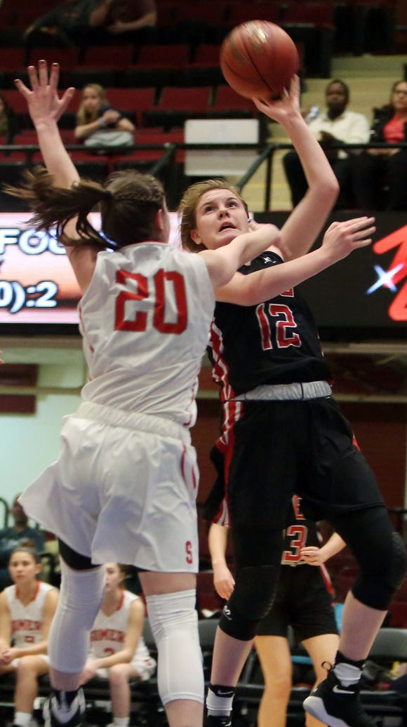 Rye's Teaghan Flaherty (12) puts up a shot in front