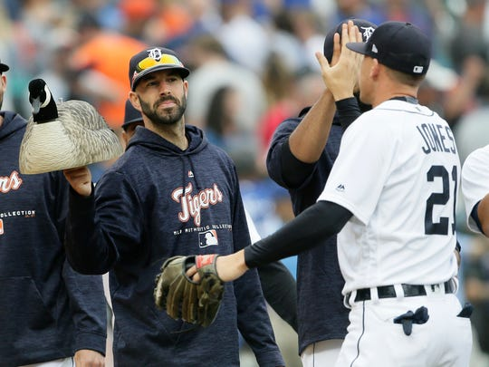"Detroit Tigers pitcher Mike Fiers, left, holds out the ""rally goose"" decoy for center fielder JaCoby Jones, following a 7-4 win over the Toronto Blue Jays, Saturday, June 2, 2018, in Detroit."