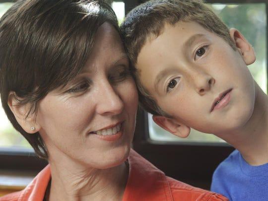 Shannon Montemurno, 42, looks at her son, Sean, 10,