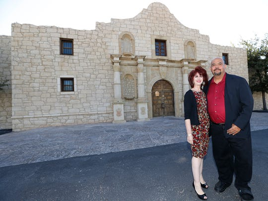Pastor Bobby Garcia and his wife Lupe Garcia stand  outside the new location of Grace Christian Center at 820 N. Raynor, with an exterior mirroring the famous Alamo in San Antonio. The Alamo Ballroom will continue to hold events in the building this year until its event contracts are completed.