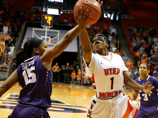 UTEP guard Starr Breedlove puts up a shot during first half action against TCU's Jada Butts. The Miners pulled away during the second half and walked away with a 79-71 win over TCU in the Don Haskins Center and will play Oregon on Monday night.