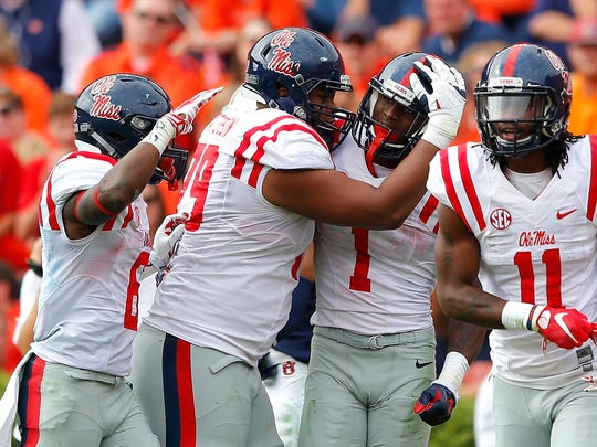 Left guard Javon Patterson (79) celebrates with wide receiver Laquon Treadwell (1). Patterson figures to be a key member of Ole Miss' offensive line this fall.