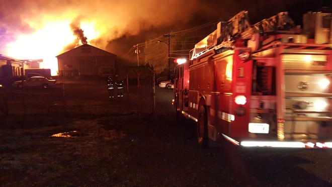 Firefighters battled a blaze in May 2015 at a warehouse complex on Fort Campbell Boulevard that destroyed three buildings, one of them the Sin City Motorcycle clubhouse. Federal prosecutors now say the fire was started by members of the Mongols motorcycle gang.
