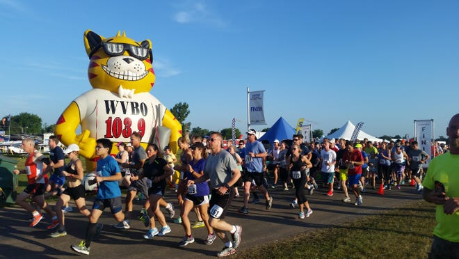 Runners started off the EAA AirVenture Runway 5K Run/Walk at 7 a.m. Saturday, July 25, 2015 at Wittman Regional Airport.