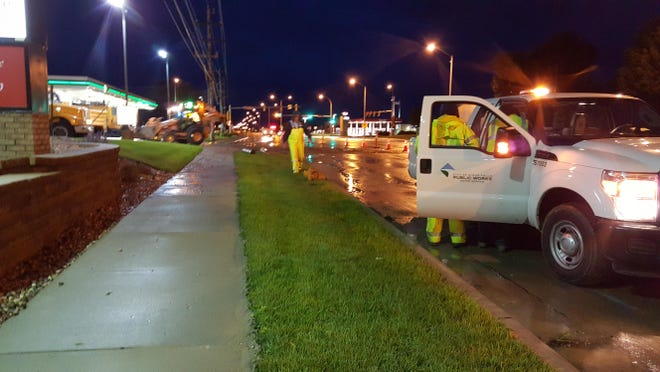 Sioux Falls Water Department personnel at the scene of a hit-and-run that knocked a fire hydrant off its base and damaged the water main just east of 41st and Sertoma early Wednesday.