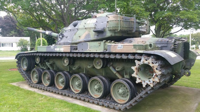 An M60 tank sits outside American Legion Post 468 on Dorsey Road in Greece.