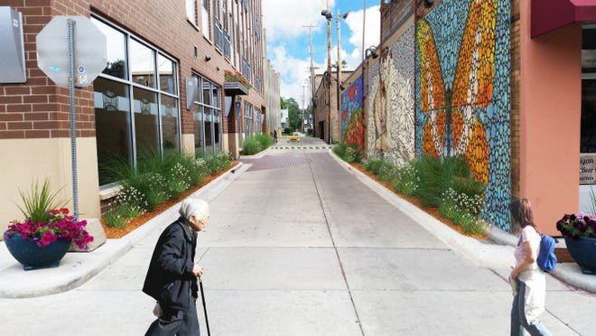 How the alley behind the Grove Street ramp in downtown East Lansing could look if a successful fundraising project adds a mosaic, lighting and landscaping.