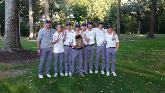Robert E. Lee's golf team, flanked by coach James Corbett, shows the state 2A championship trophy after defeating East Rockingham on Tuesday at the Golden Eagle Golf Club in Irvington.