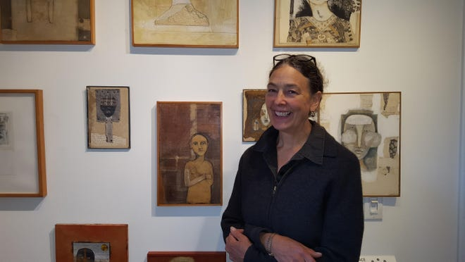Artist Judith Hoyt stands in front of her artwork on view at Wired Gallery in High Falls through Nov. 22.
