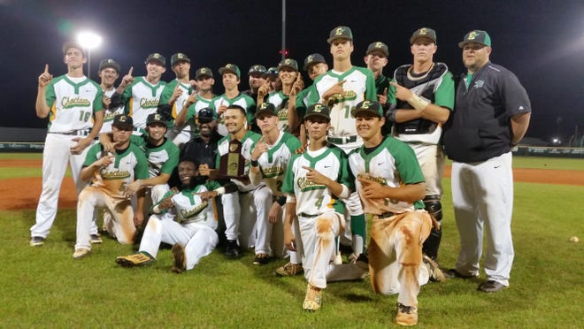 The Choctaw Indians celebrate after defeating West Florida 7-0 to win the District 1-6A championship on Thursday, April 21, 2016