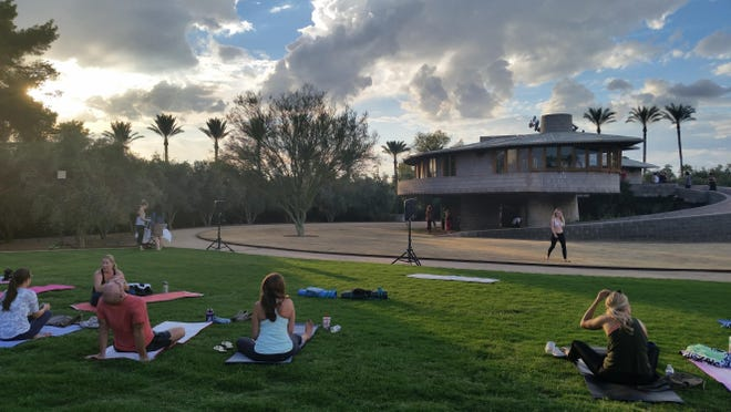 A yoga class is held outside the David and Gladys Wright House in Phoenix last year. The Frank Lloyd Wright-designed home will temporarily cease hosting daily tours and special events after May 7.