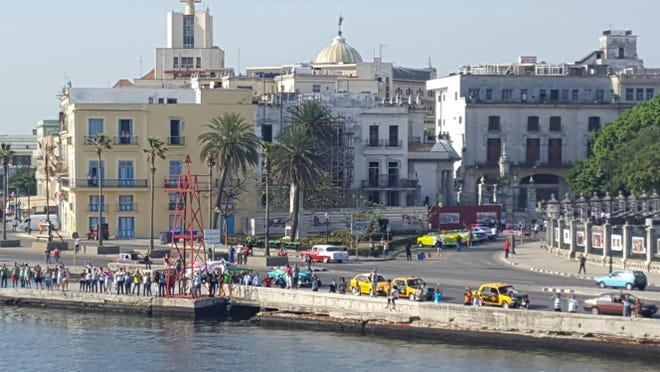 Havana residents welcome the arrival of a Fathom cruise ship from the United States, the first American voyage to the island in more than 50 years.