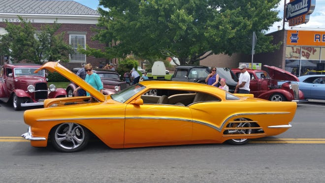 Participants check out cars on display Sunday at the Yerington Main Street Car Show.