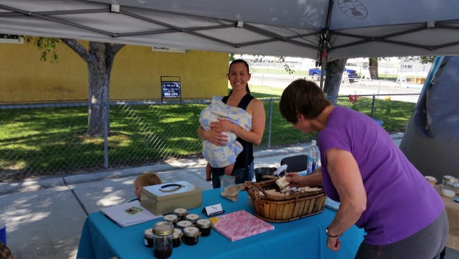 Nicole Goffinet of Yerington sells handcrafted soaps and scrubs as Hunting Borealis June 24 at the Yerington Farmers Market at the Jeanne Dini Center in Yerington.