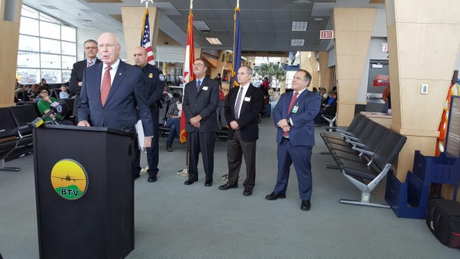 Sen. Patrick Leahy speaks Thursday at Burlington International . In the background, from left, Tom Torti, President and CEO of Lake Champlain Regional Chamber of Commerce; Customs and Border Protection Boston Field Office Director Bill Ferrara; Brian Searles, former Vermont Secretary of Transportation; Bill Hollister, Amtrak senior manager government affairs – Northeast; and Gene Richards, director of Aviation at Burlington International Airport.