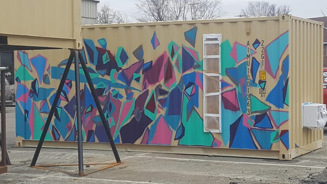 This shipping container — seen here in progress — will be used as a temporary art venue for the First Friday Art Walk in Binghamton.