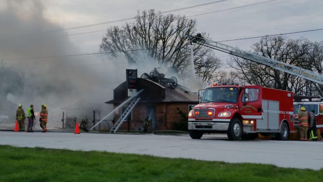 Fire fighters tend to the scene at the Oak Ridge Bar and Grill in the town of Scott, which sustained major fire damage Tuesday night.