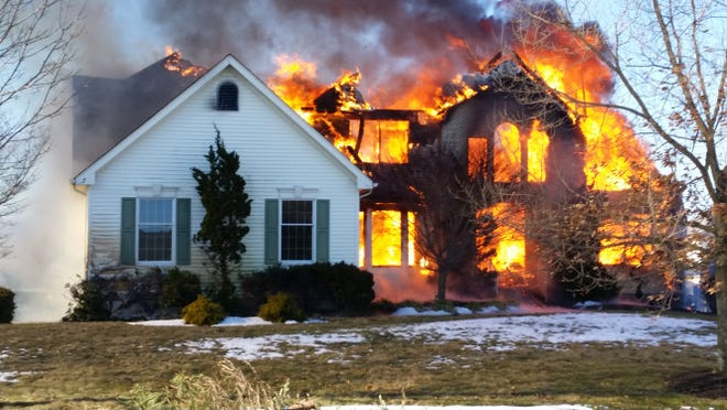 Fire engulfs a home at 7 English Path in Freehold Township.