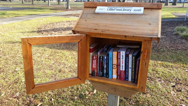 The Little Free Library along South Madison Street in St. James Park on Green Bay's east side.