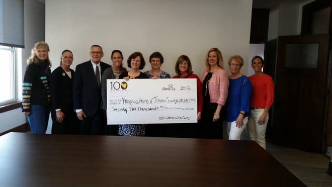 The members of the 100+ Women Who Care Hawkeye Chapter present a $25,000 check to Hospice House of Johnson County on April 10.