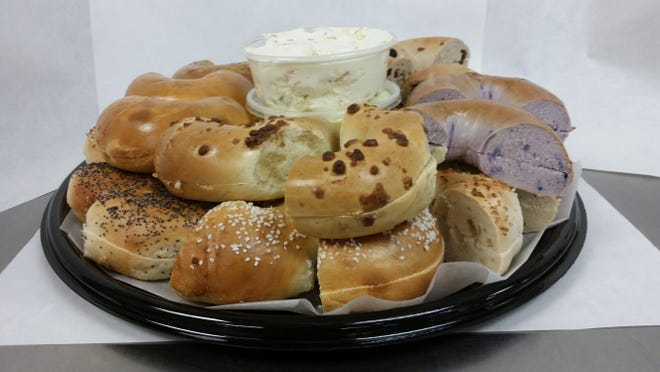 A bagel platter at Rockaway Bagel & Deli features an assortment of bagels and spreads.